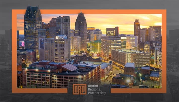 Detroit Skyline At Night With Orange Border And Detroit Regional Partnership Logo