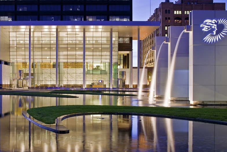 fountains in front of a well lit office building
