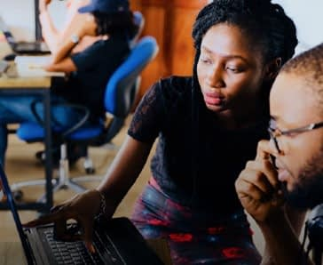 African American Man And Woman Work At A Laptop Computer Thumbnail