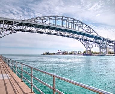 The twin spans of the Blue Water Bridges connect the cities of Port Huron, Michigan and Sarnia, Ontario.  They are the second busiest crossing between the US and Canada.