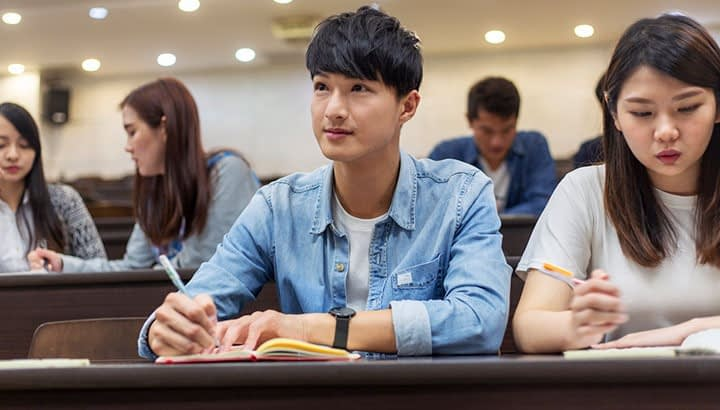 University Student Paying Attention In Class