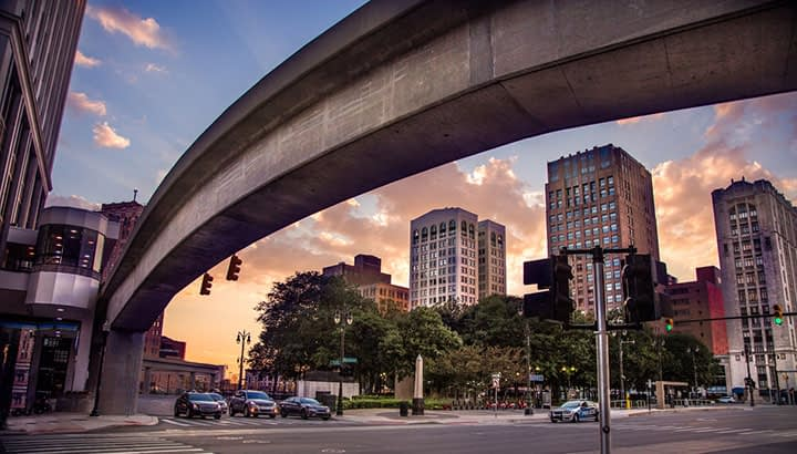 The public transportation system known as the People Mover propels itself along this monorail as seen on Woodward Avenue in Detroit Michigan. There is massive urban renewal in downtown Detroit following years of economic uncertainty associated with its insolvency of several years ago.